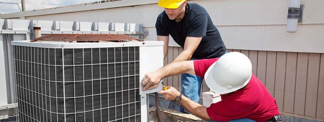 HVAC contractors installing an HVAC system in Flowery Branch, GA